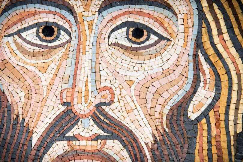 A small tile mosaic of the face of Jesus.