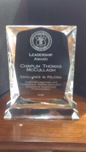 A picture of a glass leadership award.