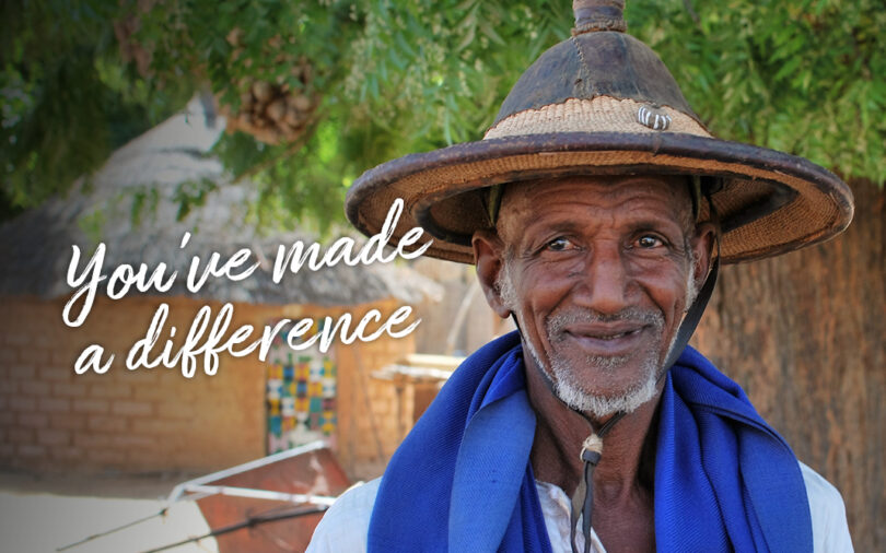 "A man is smiling at the camera, the words ""You've made a difference"" are over the picture."