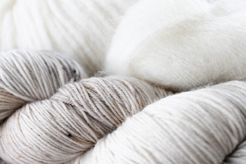 White and grey yarn and wool.