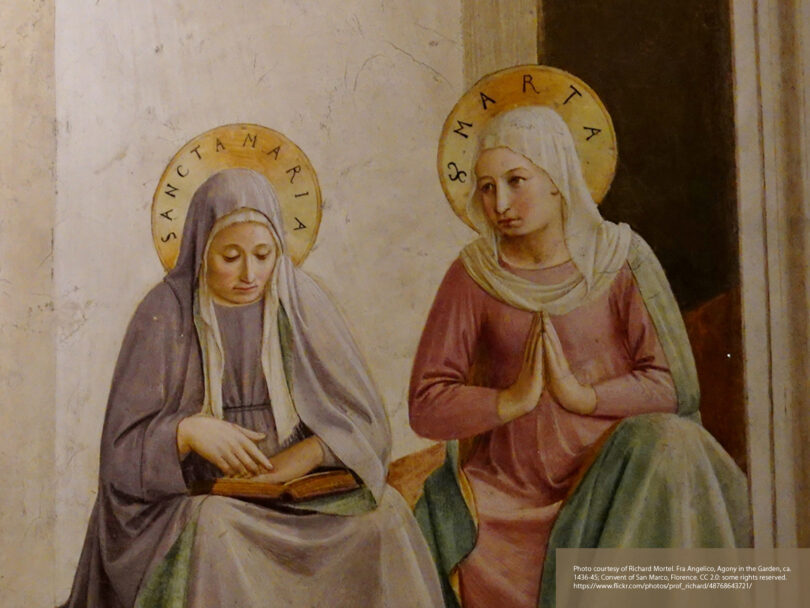 A medieval style painting of two people sitting beside each other. They both have halos, one is praying and one is holding a book