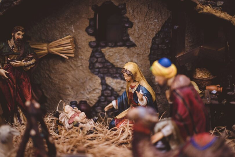 A close up photo of a porcelain nativity scene where Mary and baby Jesus are in focus.
