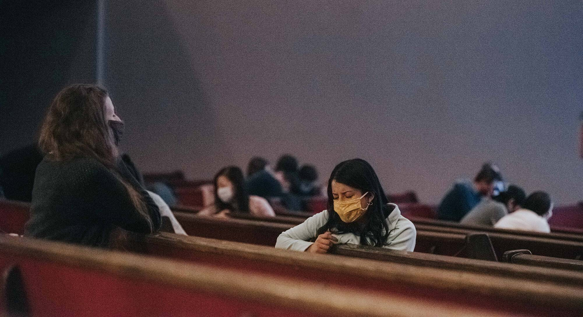 Coquitlam Alliance Church. Two masked women praying in a pew.