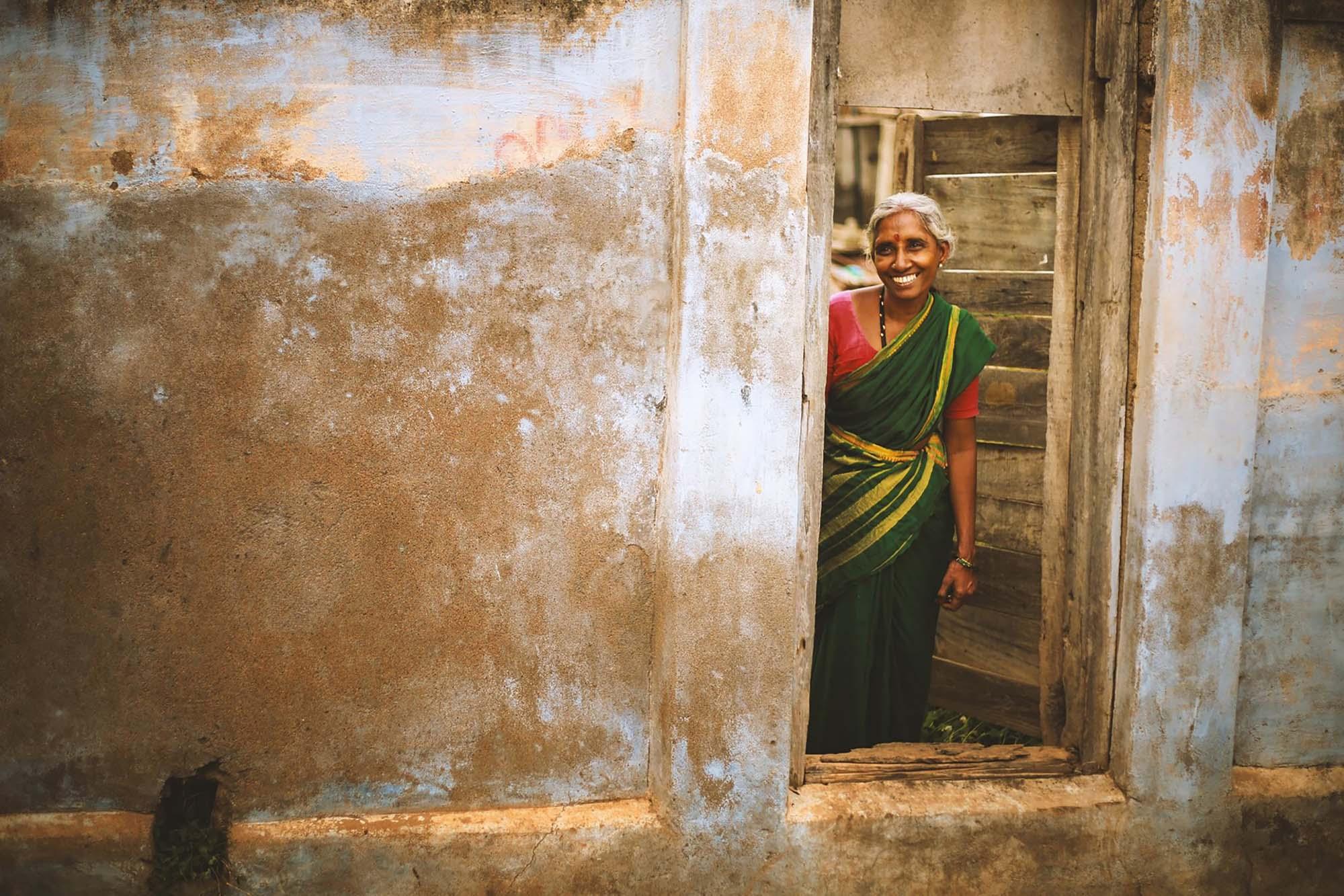 Woman smiling in a doorway
